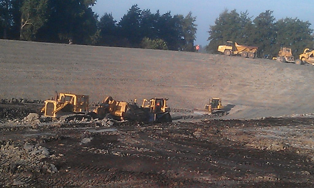 earth moving machinery for reservoir - dumpers and dozers