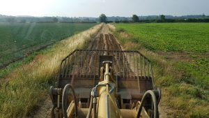 DURING - Ripping and grading of farm track by 963c Drott.